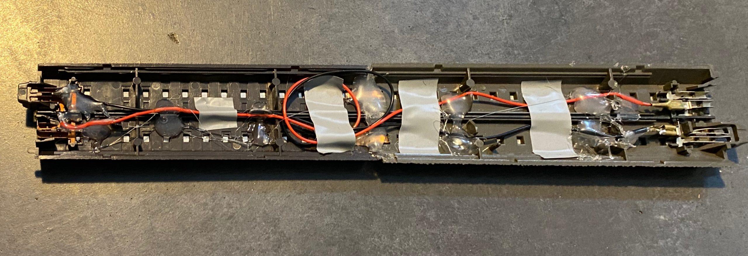 Back of an Märklin α to C track adapter