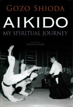 Gozo Shioda throwing two uke in a dark dōjō