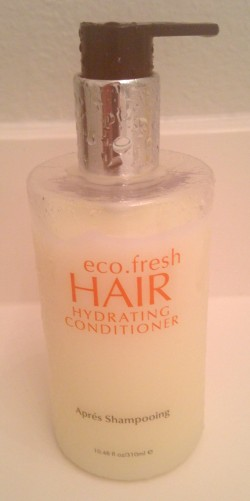 Bottle of conditioner labelled 'Aprés Schampooing' where it should be