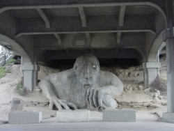 The Fremont Troll Steve Badanes, Will Martin, Donna Walter and Ross Whitehead, 1990. Ferroconcrete, 18-feet tall. Under the north end of the Aurora Street Bridge, Seattle, Washington.