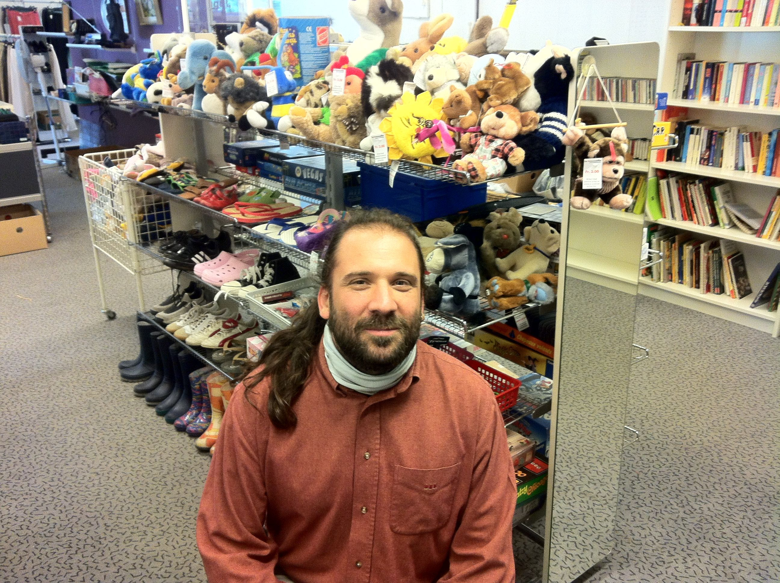 Matthias in Front of the plush toy shelf