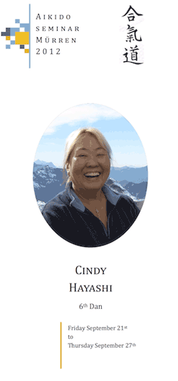 Flyer for the Aikidō stage in Mürren, with a picture of Cindy Hayashi's face in front of the alps.