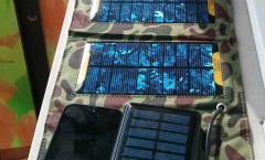 Foldable array of solar cell, portable auxiliary battery with solar cell and iPhone 5 charging