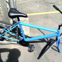 Fake bike with square wheels, broken.
